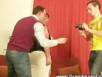 Mature woman fondled by two guys before blowjob