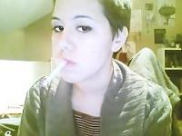 Short hair brunette smoking with nose exhales and dangling