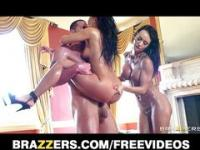 Two oiled up Latinas get ass fucked