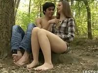 Barefoot couple having fun in the forest
