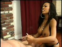 Big breasted ebony beauty Lacey Duvalle strokes a white cock to orgasm
