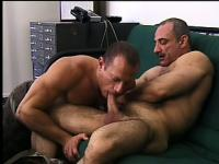 Horny mature army studs engaging in hot gay action in the office