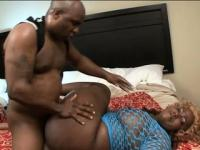Chunky chocolate lady has a black guy hammering her snatch on the bed