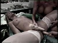 Sexy nurses bang each other with their toys in a hospital room