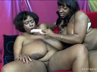 Two big black chick with huge tits use toys and tongues on their pussy