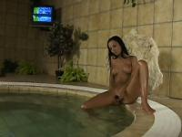 Tight-bodied brunette strokes her smooth wet clit in the jacuzzi