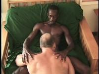 Hot black boy gets his dick sucked and his ass fucked by a hunky white dude