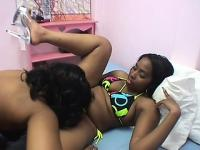 Ebony hotties relish the taste of each other's peaches as they drive them to orgasm