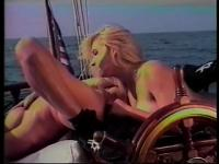 Two ravishing blonde lesbians fulfill their sexual desires and fantasies out on a boat