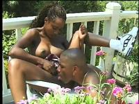 With the sun bathing her body, a busty caramel beauty gets banged hard by a black stud