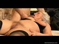 Sexy grandma moans like crazy at the mercy of big young schlong