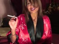 Beautiful woman smokes for you