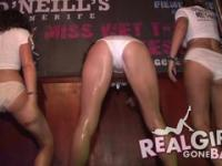 drunken college girls strip naked on stage during a wet t shirt contest