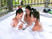 Three busty girls in a Jacuzzi
