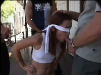Saphire Rae starts out blindfolded and gets naked to fuck them all