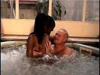Interracial couple getting at it in the hot tub and exchange body fluids