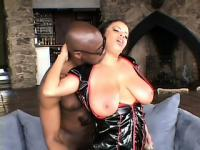 Busty as fuck tart in a vinyl corset gets filled with a black dick