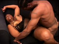 Chunky ebony woman has a muscled black stud fucking her twat on the sofa