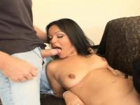 Sensual Latina with big hooters getting double penetrated on the couch