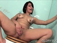Slutty brunette rubbing cock on gloryhole