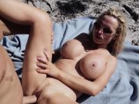 Nikki Benz fucked by the seashore in her pussy and tits