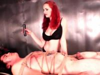 Kinky mistress pouring hot wax on hard cock