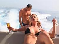 Tarra White smoking cigarette on boat