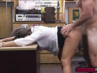 Big tittied brunette swallows dick and fucks hard at the pawnshop