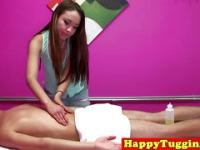 Inked asian masseuse tugging hard cock