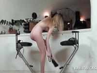 Blonde temptress gets naked and rubs her bald cunt