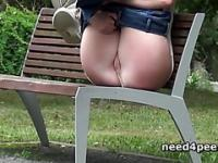 Gorgeous blonde pissing on a bench outdoor