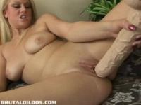 Armani stretches her wet pussy out with a massive dildo