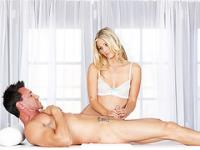 Flowing blonde hair masseur Scarlet Red enjoys cock milking