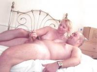 Sexy mature lady giving handjob