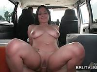 Chesty hoe jumping cock on the bus floor