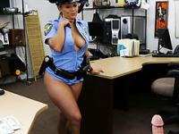 Busty cop chick grabs and sucks a dick