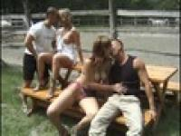 Naked babes all get fucked on a park bench
