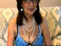 Good looking granny with no shayme on webcam