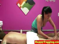 Busty tugging asian masseuse pulls and sucks
