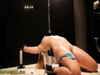 Whipped and clamped slave