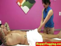 Asian masseuse wanks clients cock and rubs his balls