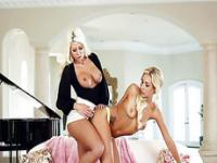 Two stunning lesbians Carmen and Jazy strap on fun in the sofa
