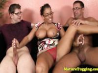 Spex milf tugging two cocks until they blow