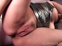 Aroused bitch gives titjob and BJ on gloryhole