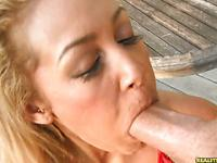 Watch Tinslee suck a big cock as she rubs her big bush.