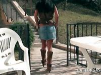 Sex doll brunette walking outdoor shows her cunt upskirt