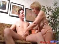 Blonde cute older woman bouncing on top