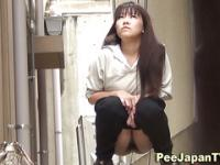 Hairy asian box drips pee