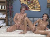 Nicole and Alina fills their bodies with oil and probes their holes with toy