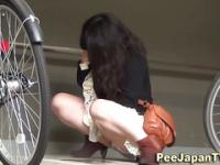 Asian babe caught peeing outside